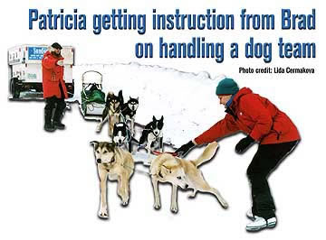 Patricia getting instruction from Brad on handling a dog team
