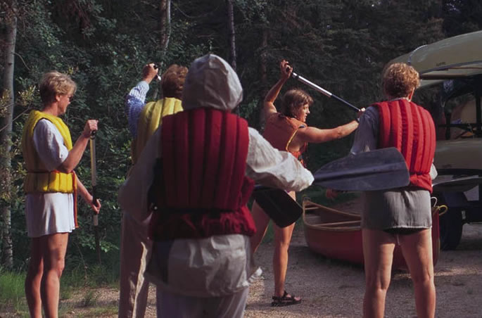 A CanoeSki all women's canoeing group receiving pre-trip paddling instruction