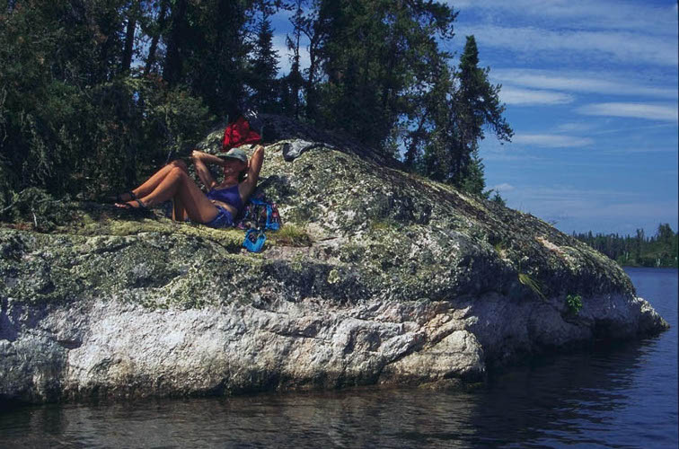 Relaxing on Canadian Shield rock