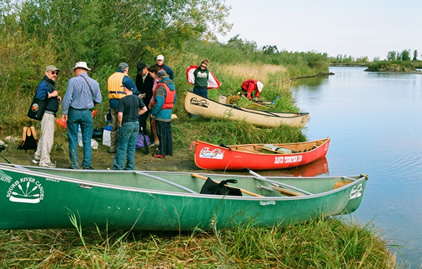 A CanoeSki group launching canoes on the South Saskatchewan River
