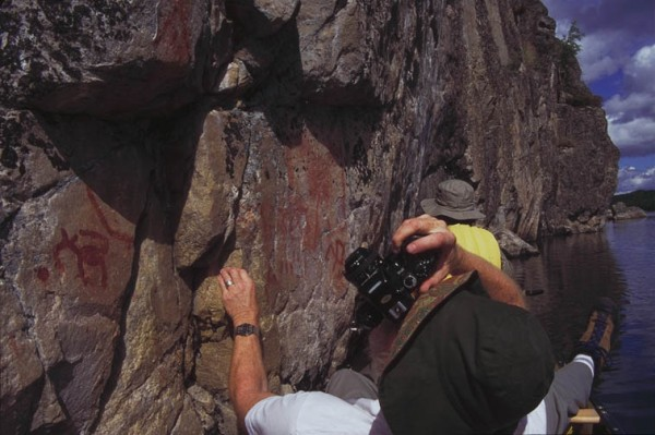 Courtney Milne photographing rock paintings