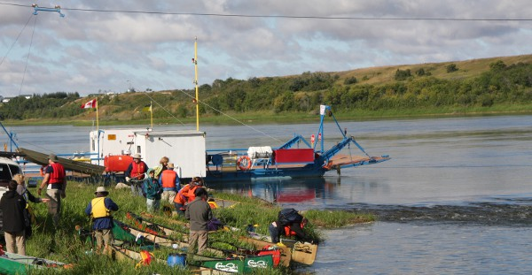 CanoeSki canoeing group launching at the Hague Ferry on South Sask River